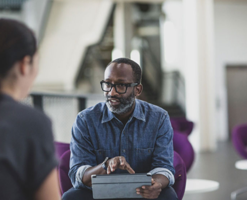 African-American middle-aged man talking to a person